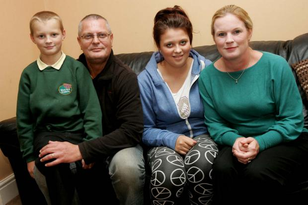WATCHING THE PURSE: Alex and Samantha Blackham with children Sophie and Thomas