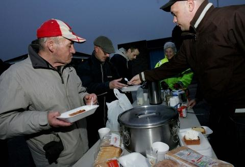 Volunteers feed the homeless and hungry
