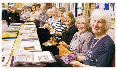 Darlington and Stockton Times: IN STITCHES: Members of the Darlington branch of the Embroiderers' Guild, whose exhibition of work depicting the North's mining heritage is showing in London. Chairwoman Joy Bradshaw is in the foreground, far right