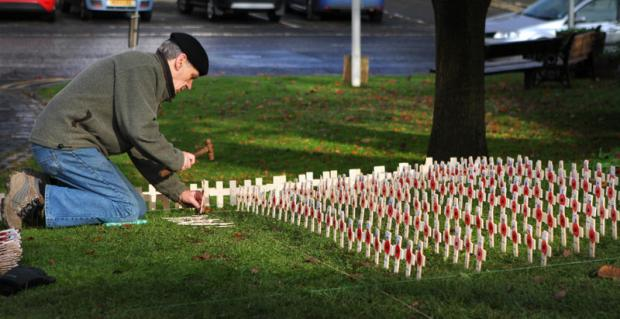 FOR OUR HEROES: Peter Ovington plants out the crosses in Sedgefield's remembrance garden. Below, some of the crosses