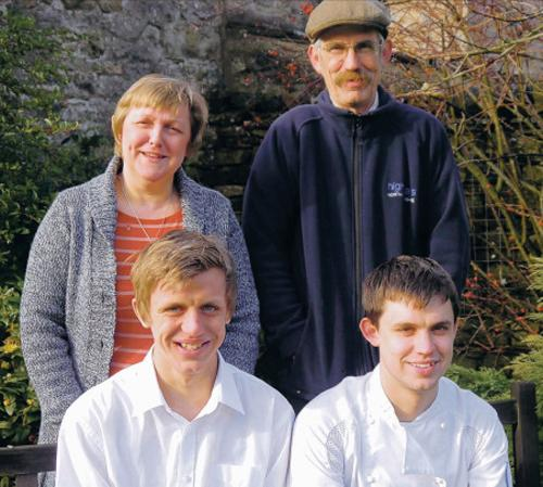 WAIT: Josh, left, who has taken up a role at Raymond Blanc's Le Manoir aux Quat'Saisons with brother Tristan, and proud mum and dad, Karen and Tim Prudden