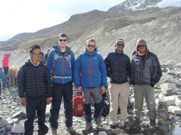 Scott Baker (centre) with Mark Cairns (left of centre) at the Everest Base Camp during their charity challenge