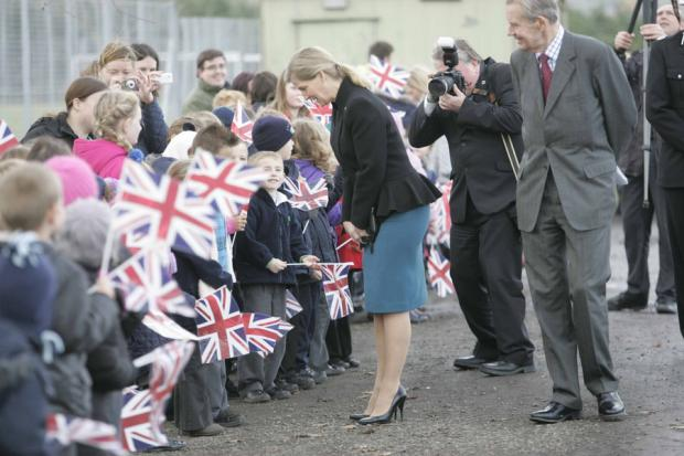 Darlington and Stockton Times: ROYAL HI: Sophie Countess of Wessex is greeted by flag-waving children in Escomb