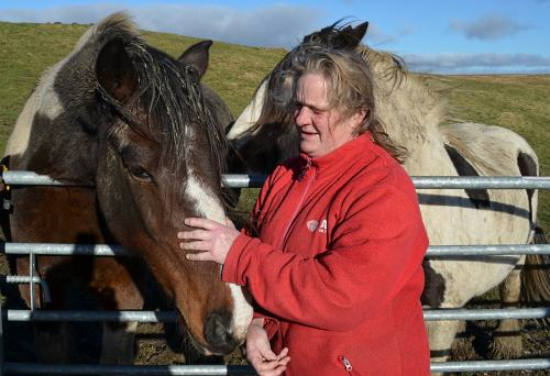 Pat Kingsnorth, who runs the Ark on the Edge sanctuary, with skewald pony CJ who has spent all his life at the rescue centre.