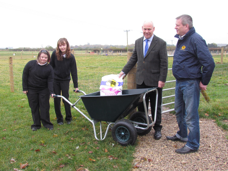GIFT: Ella Coulson, left, Bethany Sidell, headteacher Jonathan Tearle and Mike Dennis of WE Jameson