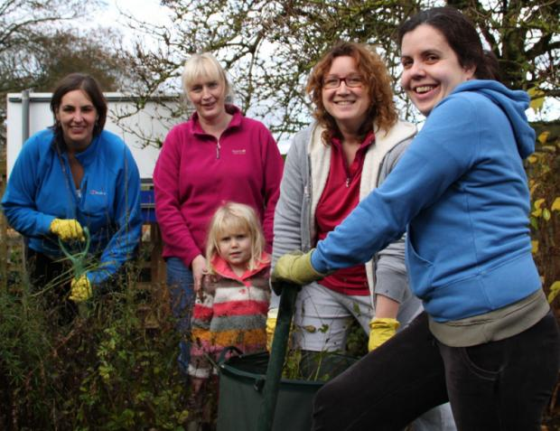 Darlington and Stockton Times: HELPERS: Gardening team Kath Margetts, Dawn Fuller, Louise and Evie Alder, with Claire Forth