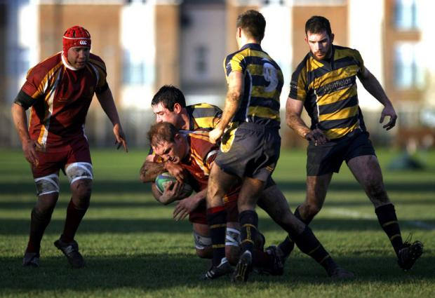 DRIVING FORCE: Middlesbrough's Matty John, red shirt, is tackled by Durham's Peter Dent at Acklam Park last weekend