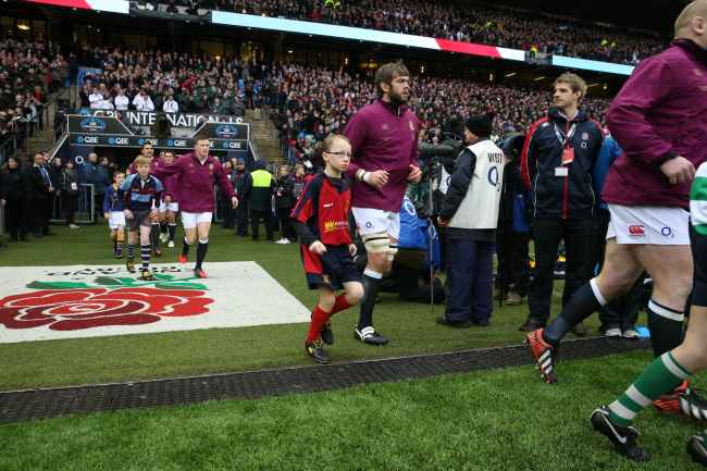 England international Geoff Parling runs out at Twickenham with mascot Josh CRrozier