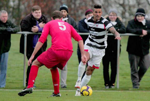Darlington and Stockton Times: NO WAY THOUGH: Team Northumbria defender Ross Wilkinson, left, keeps Darlington midfielder Leon Scott at bay during Quakers' 2-0 defeat on Saturday