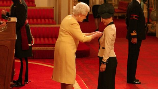Darlington and Stockton Times: Anna Kennedy receiving her MBE from the Queen - pa