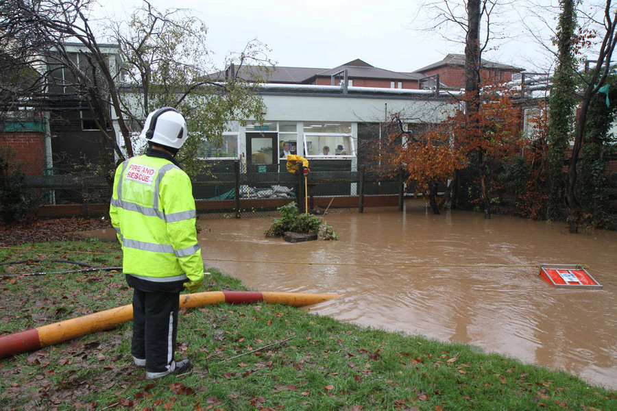 RESCUE EFFORTS: The overflowing Sun Beck, behind the Friarage hospital, that caused flooding to the operating theatres