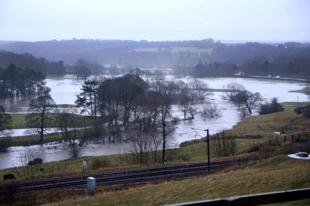Darlington and Stockton Times: OVERFLOWING: A watery landscape looking east from Brandon to Croxdale showing how the River Brownie has burst it banks