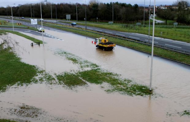 DAMP CONDITIONS: The A66 at Long Newton is under water after being flooded again