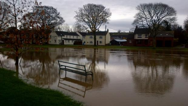 Darlington and Stockton Times: UNDER WATER: The beck at Brompton broke its banks