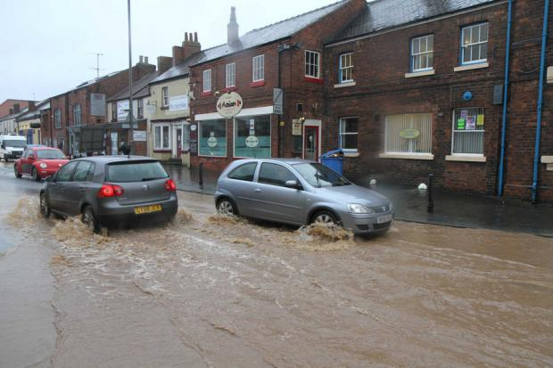 Motorists driving through flooding on Friarage Street, Northallerton in 2012