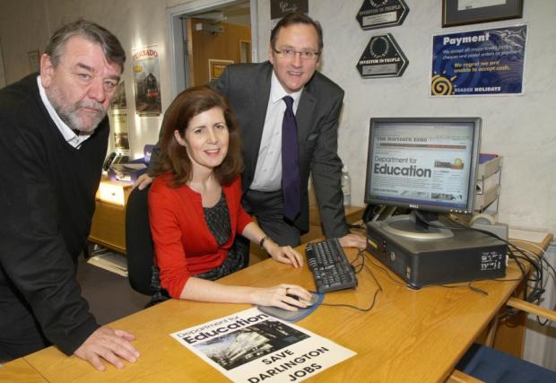 Darlington and Stockton Times: Councillor Bill Dixon, Jenny Chapman MP and Phil Wilson MP signing the online petition to save education jobs at Darlington's Mowden Hall