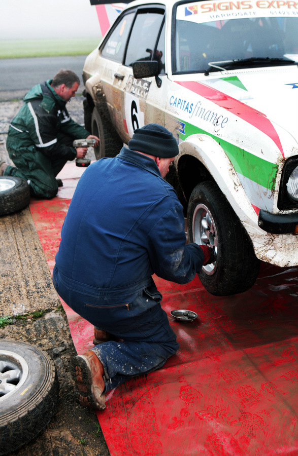 PRESSURE ON: Mechanics work on Tim Pearcey and Neil Shanks' Ford Escort RS1800 during the Roger Albert Clark Rally at Croft Circuit last weekend
