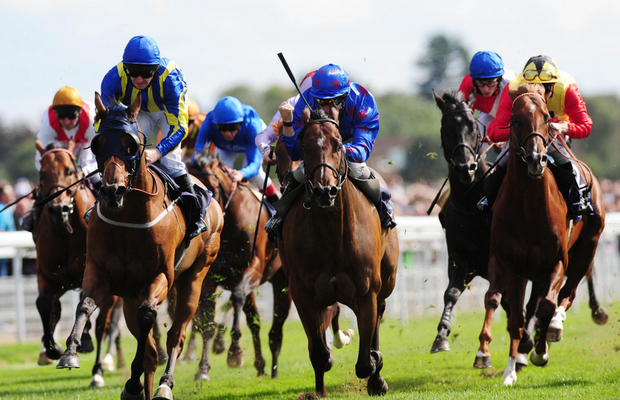 PAST GLORIES: Borderlescott ridden by Neil Callan (right) beats Benbaun ridden by Johnny Murtagh (left) to win the Coolmore Nunthorpe Stakes in the Ebor Festival at York Racecourse in 2009