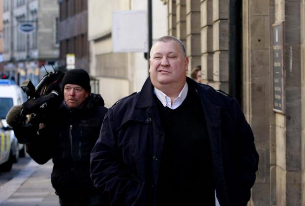 IN COURT: Former chairman of Cleveland Police Authority, Dave McLuckie, right
