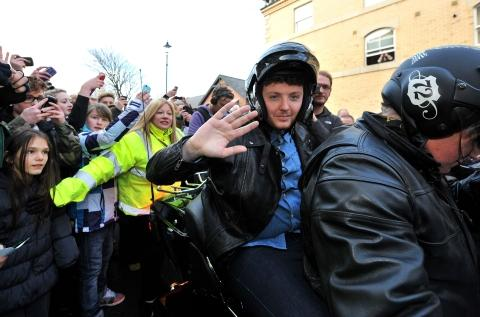 James Arthur arrives by motorcycle in Saltburn