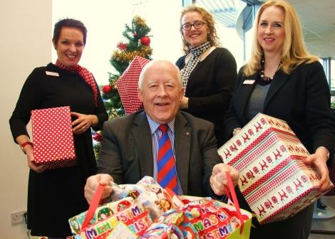 Sherwoods staff with gifts donated for Darlington Cares Christmas children's appeal, L-R, Carole Cottingham, Alasdair MacConachie, Nicola Jowett and Jane Longstaff