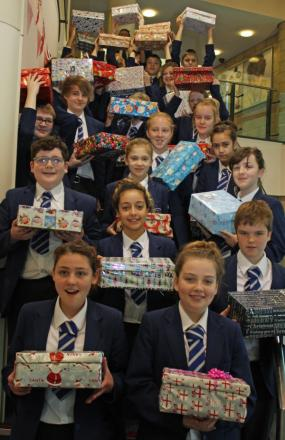 Students at The King's Academy, in Coulby Newham, queue up with their boxes for the Operation Christmas Child appeal