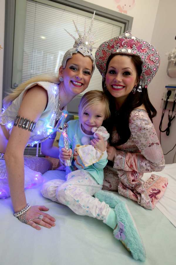 Cast members Lisa Lynch (left) and Amy Bruce from the Theatre Royal's production of Aladdin visit five-year-old patient Ria King during their visit to the Royal Victoria Infirmary