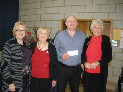 BLOOMING MARVELLOUS: Members of Darlington Flower Club present a cheque to Kevin Fitzpatrick, from the British Heart Foundation