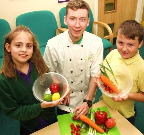 : Pupils Jessica Martin and Josh Purvis with the Food Education Company chef John Perrett getting ready to make some healthy treats at West Park Academy, Darlington