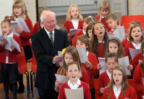 Peter Lawrence joins the choir from Headlands Primary School, at the start of the Missing People Northern Carol Service, at St Chad's Church.