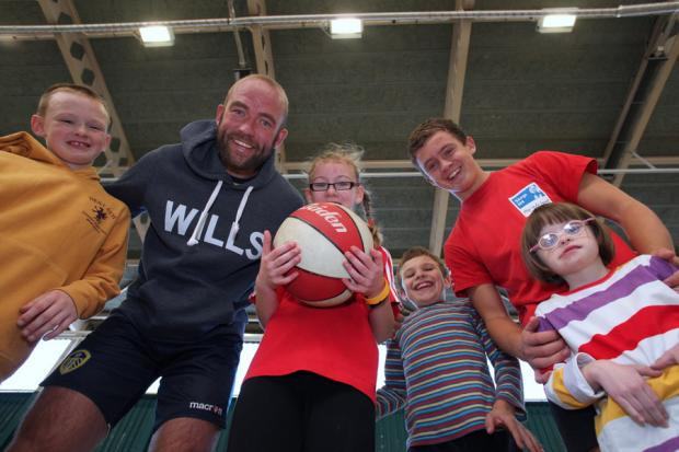 CLUB CASH: Members of the Sportsability club in Bedale celebrates their donation from a trust set up in memory of Ben Hyde