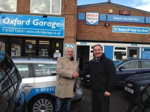 NICE GUY: David Essex with garage owner Kieron MacDonald