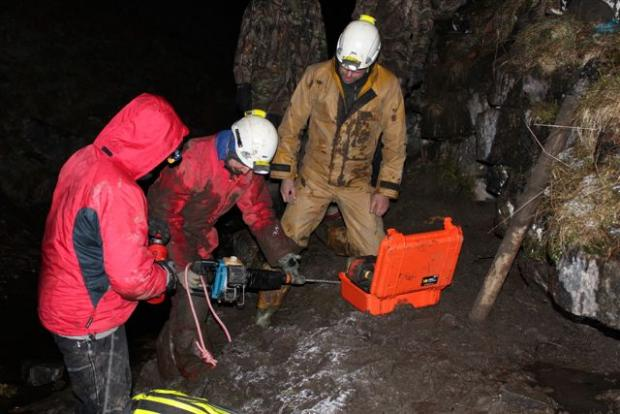 RESCUE BID: Search and rescue team members try to reach a terrier stuck underground.