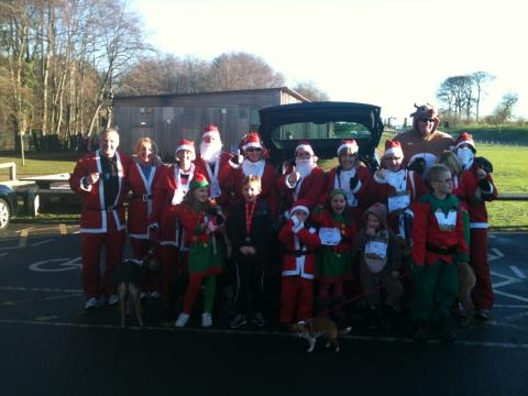 Sharon Whitfield and Zoe Kent, pictured centre back row, with fellow Santas at their charity event