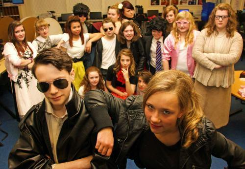 Darlington School of Mathematics and Science students, front, Thomas Towle, 14, as Danny, Caitlin Sear, 13, as Sandy, and the rest of the cast of Grease