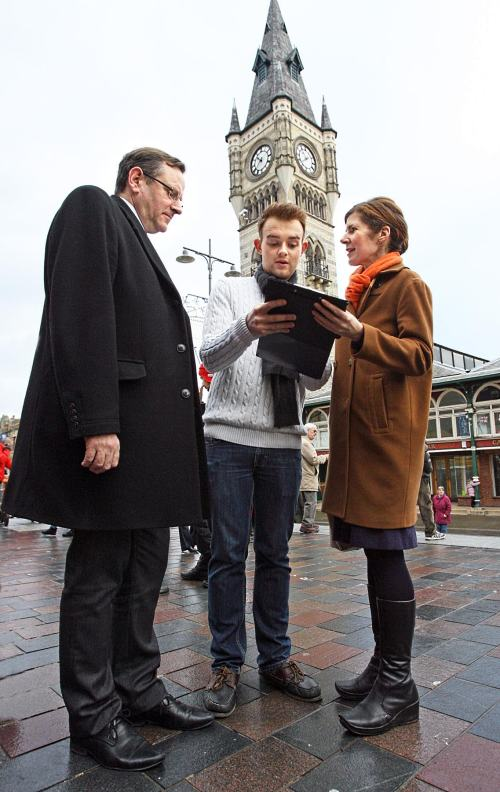 Lewis Cairns signs the petition flanked by MPs Phil Wilson (left) and Jenny Chapman.