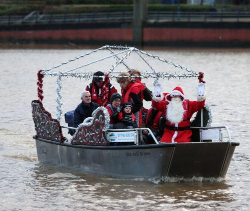 Santa and volunteers aboard the 'wheely boat' on the River Tees at Stockton.