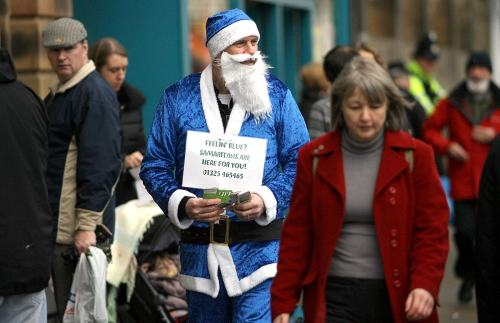 Blue Santa hands out contact details for The Samaritans