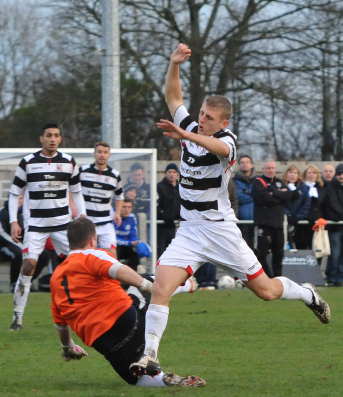RACE FOR THE BALL: Darlington's David Dowson challenges the Newton Aycliffe keeper during the Northern League clash last Saturday