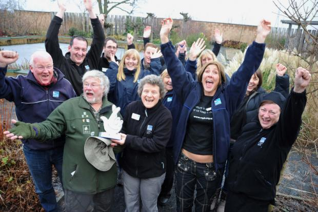 AWARD: Bill Oddie hands over the award to staff and volunteers at RSPB Saltholme