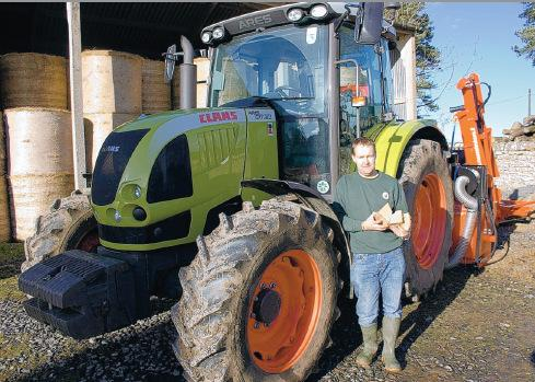 PROJECTS: Steven Urwin and his Claas tractor, above, which is fitted with equipment to chop trees into logs