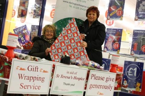 ALL WRAPPED UP: Volunteer gift wrappers Nancy Spencer and Brenda Lees on their stall