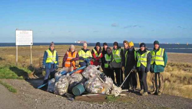 Volunteers with just a fraction of the litter collected. Photo credit Ted Parker.