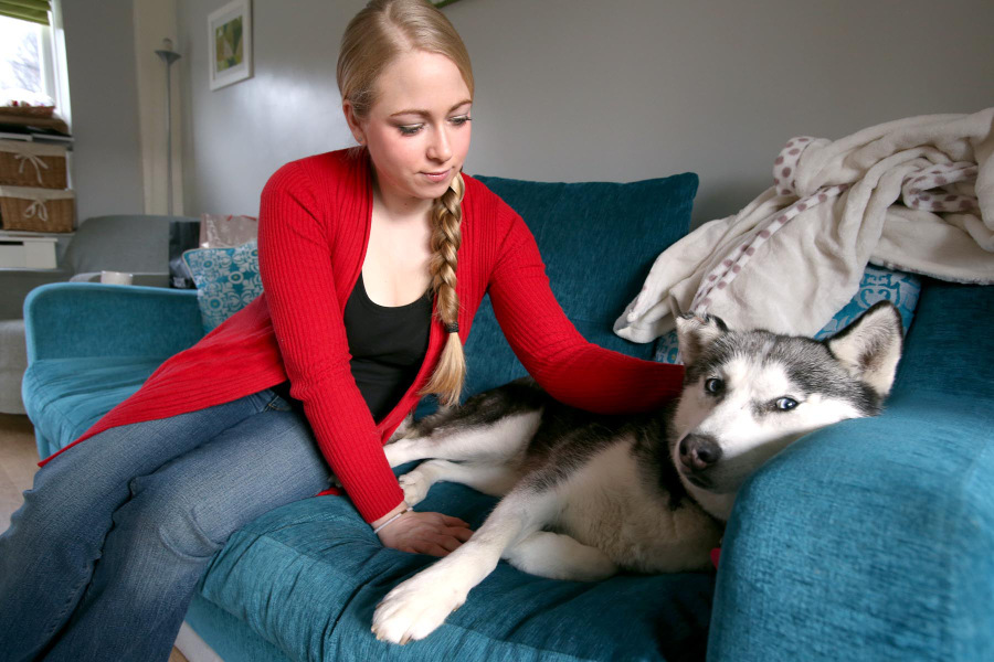 LUCKY TO BE ALIVE: Caroline Douglas and her dog, Skye, recovering after the accident in West Auckland Road