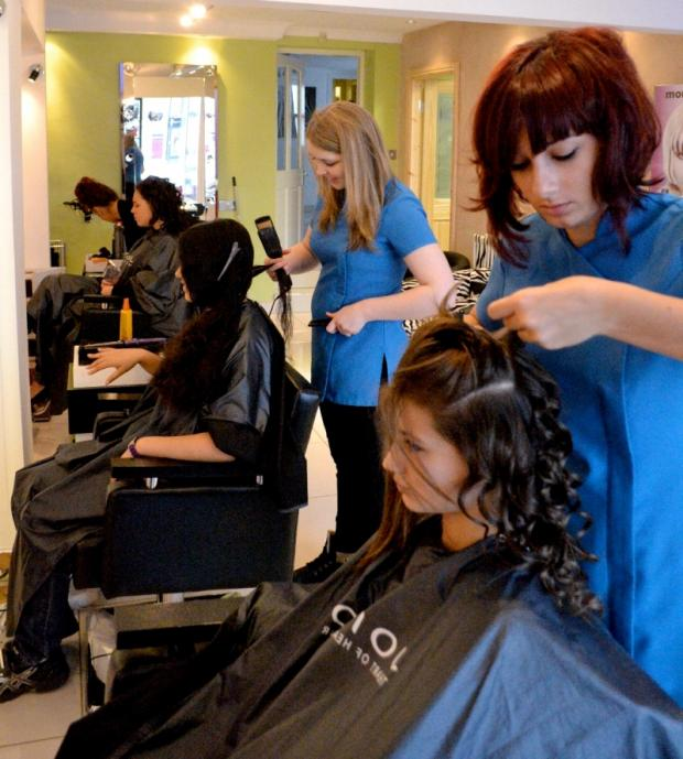 SALON SKILLS: Student Aaron North's picture of Amy Bailey and Ellie Chapman at work on models Shauna McKie and Jasmin Williams at the Zhoo salon.