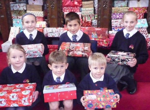 BOX APPEAL: Back row Emilia Hawcroft, 10, Barnard Castle; Alfie Todd, 10, Richmond; Josephine Powell, 11, Bedale; and front row Aasta McGregor-Towers, 6, Weardale; Max Rycroft, 7, Barnard Castle; Ned Michelin, 4, Mickleton, with the shoe boxes.