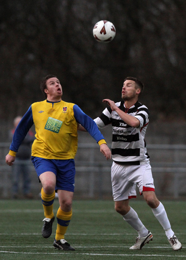 RETURNING HERO: Stephen Harrison, right, pictured playing for Darlington last season, has returned to the club