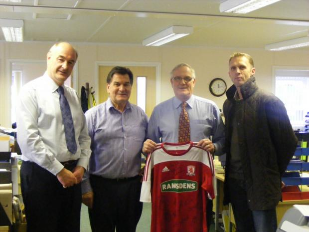FAREWELL: Tony Simpson, second right, receives the signed Middlesbrough shirt from Steve Vickers, far right. With them are Peter Hull, far left, and Kevin Shaw