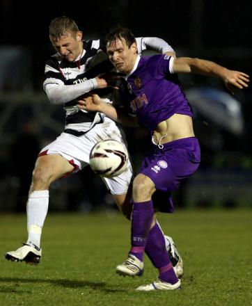 STALEMATE: David Dowson and Chris Mason in last year's 0-0 draw between the sides