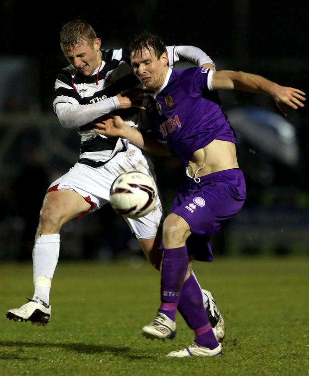 STALEMATE: David Dowson and Chris Mason in Wednesday's 0-0 draw between Darlington and Spennymoor